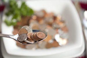 Löffel mit Kleingeld