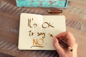 """Aufgeschlagenes Notizbuch in dem der Satz steht"""" Es ist ok, nein zu sagen"""""""
